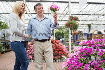 Couple looking at potted flower
