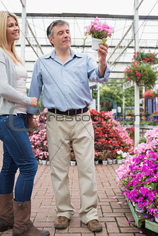 Couple looking for a plant