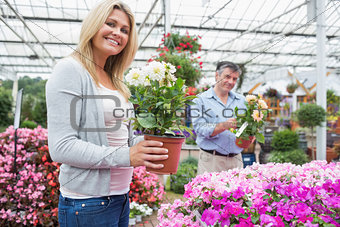 Couple looking for plants together