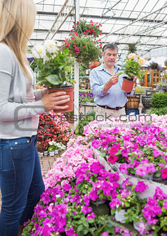 Couple picking out plants