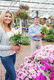 Couple choosing flowers together