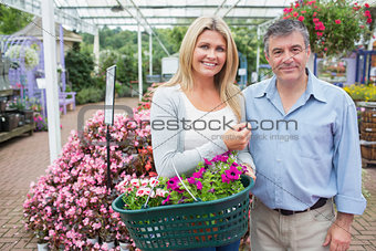 Smiling couple buying plants