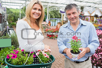 Couple choosing flowers in garden center