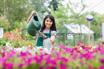 Cheerful gardener watering plants