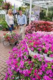 Couple pushing trolley outside garden center