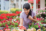 Woman looking at plants in garden center
