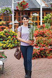 Woman carrying daisy plant