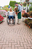 Woman in wheelchair buying potted plant