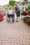 Garden center employee and woman in wheelchair
