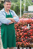 Male florist having arms crossed