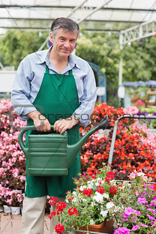Man holding a watering can