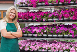 Florist standing amongst shelves