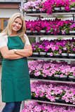 Florist having arms crossed standing in garden center