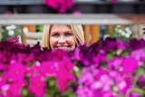 Woman looking through flower shelf