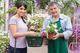 Happy customer with garden center worker