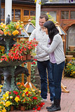 Couple looking at red plant