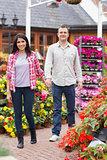 Couple holding hands in garden center