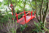 Red bridge in forest