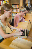 Woman at study desk using laptop