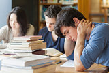 Student falling asleep in library