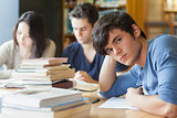 Student leaning on table looking tired