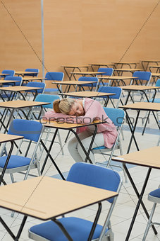 Student napping in exam hall