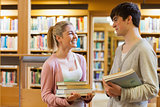 Couple smiling at each other at the library