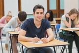 Man looking up from exam and smiling