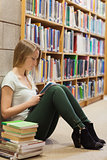 Woman studying on library floor