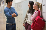 Friends talking in college hallway