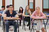 Students sitting at the classroom listening