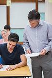 Teacher talks to a student