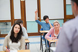 Student raising hand to ask question