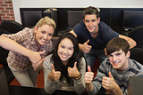 Students giving thumbs up