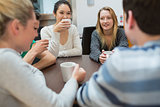 Students sitting at the table drinking coffee