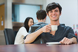 Man sitting holding cup of coffee
