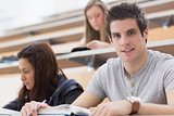 Student looking up from lecture and smiling