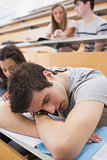 Student sleeping at the lecture hall