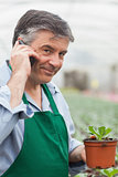 Man calling and holding a seedling
