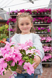 Little girl showing pink flowers