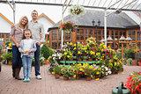 Family standing in the garden center