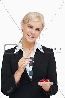 Blonde woman holding key and small car