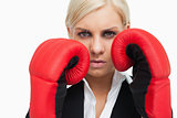 Serious blonde woman with red gloves fighting