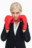 Serious woman wearing red gloves