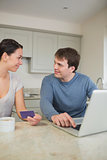 Couple using credit card online