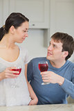 Happy couple with red wine