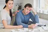 Couple getting stressed over bills