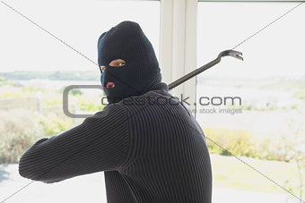 Burglar swinging crow bar