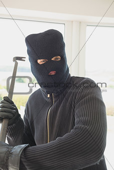 Robber holding a crowbar