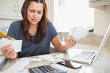 Young woman getting stressed over finances